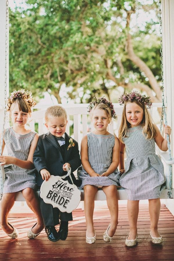 stripe flower girl dresses and one cute ring bearer. http://www.weddingchicks.com/2013/09/20/wedding-in-pink-and-gold/