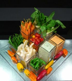 No veggie tray . . . problem solved. Place your vegetables in vases. Great idea.