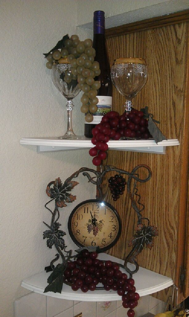 delightful Kitchen Wine Decor #3: Grape and Wine decor. Corner of kitchen cabinet.