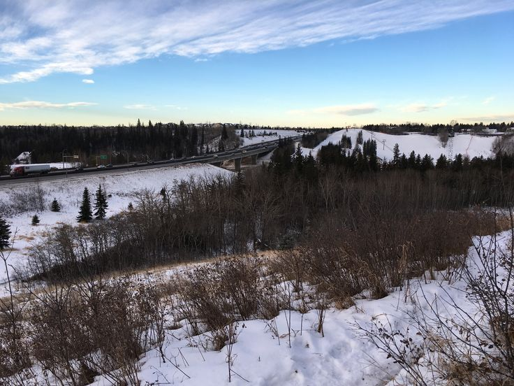 A winterscape. Relaxed and devoid of spectacular beauty, it's radiance is in it's simplicity. A blue sky scraped by find clouds colours and highlights the subtle earthtones of nature. []  www.thebestrate.ca