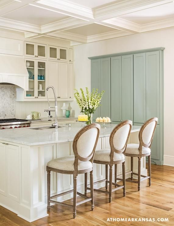 Ivory Kitchen Features Ivory Shaker Cabinets Paired With Marble Countertops And A Vertical Ivory