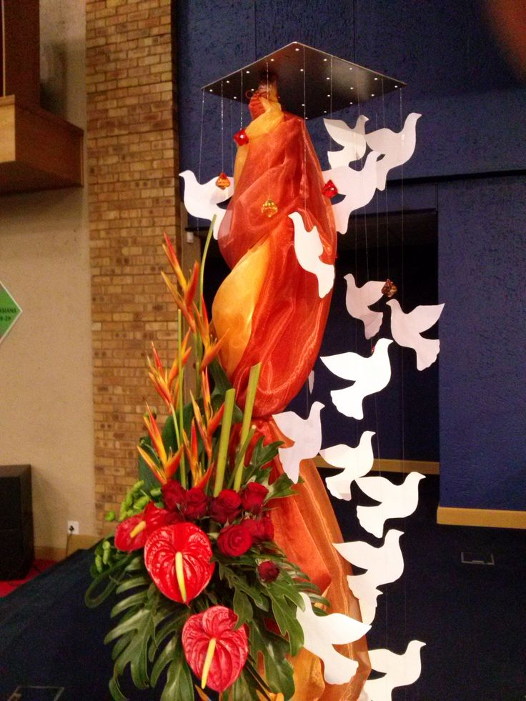 Pentecost flower display with dove mobile incorporated in arrangement.