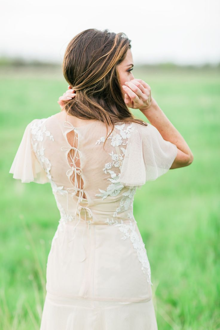 romantic wedding dress backs - photo by Anastasia Strate Photography http://ruffledblog.com/elopement-inspiration-with-a-vintage-pink-thunderbird