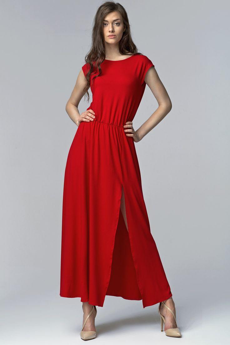 """Zmysłowa długa letnia sukienka z krótkimi rękawami wykonana z lekko """"lejącego"""" materiału. Góra o prostym kroju dopasowana w biuście, dół szerszy z rozcięciem na kolano. Wszyta gumka w talii tworzy ciekawe marszczenia. Plecy kopertowe z kuszącym wycięciem na dole. Będziesz w niej świetnie wyglądała niezależnie od okazji przykuwając uwagę męskiej części towarzystwa. Dostępna w dwóch wariantach kolorystycznych."""