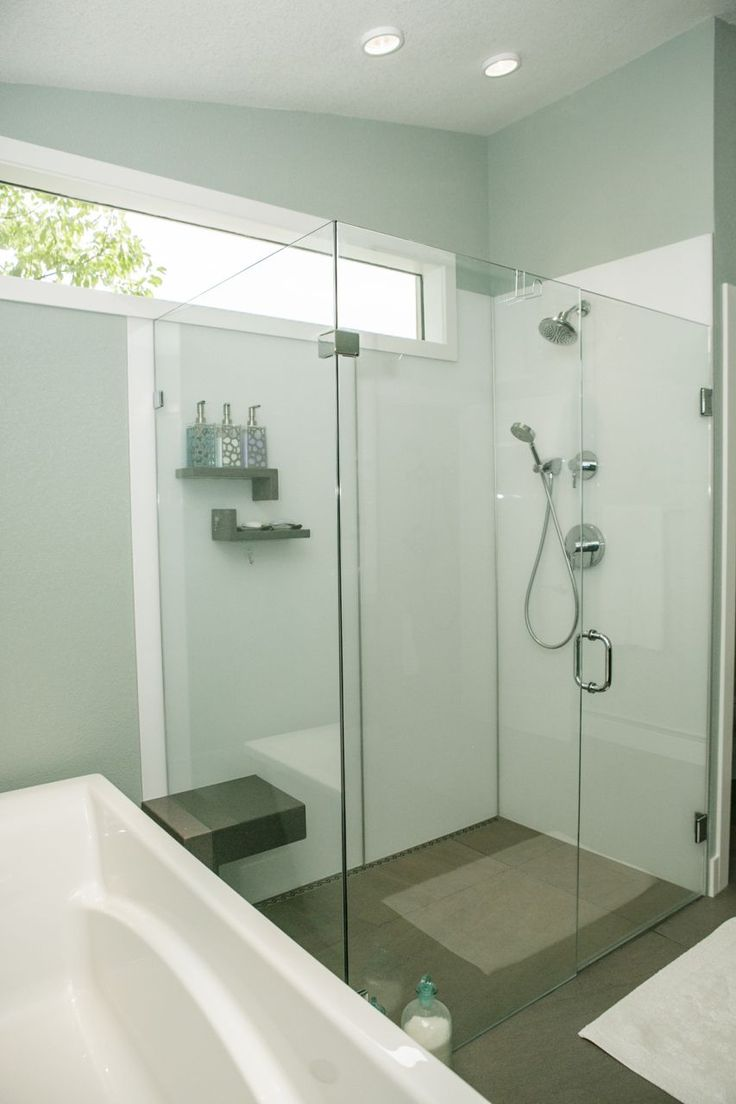 Grout free high gloss acrylic shower wall panels in a modern bathroom