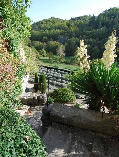La Louve, the private garden of Nicole de Vésian in Bonnieux, Provence, France. This influential garden has multiple terraces filled with elegant topiary and sculpted trees.