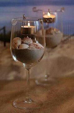 Table decoration that you can reuse after the wedding rather than having a bunch of leftover centerpiece glassIdeas, Candles Holders, Teas Lights, Beach Theme, Centerpieces, Wine Glasses, Beach Wedding, Center Piece, Wineglass