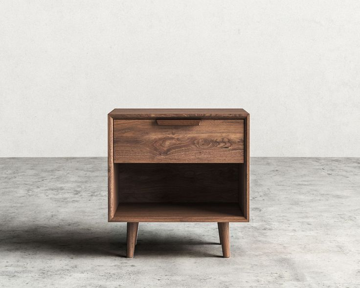 Asher is a mid-century modern inspired single-drawer night stand with tapered legs and beautiful dark-stained walnut veneer. Get the entire bedroom set!