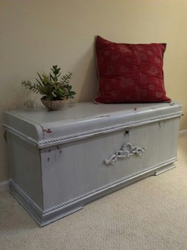 This vintage cedar chest got a makeover. The first step was to add decorative wood trim around the lid and base of the chest. A dimensional  carving added interest to the plain front of the chest. The project was completed using grey chalk paint followed by a limewash and polyurethane