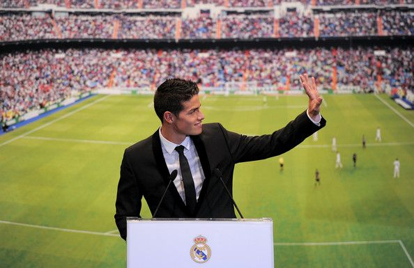 James Rodriguez Photos Photos - James Rodriguez waves to waiting supporters during his unveiling as a new Real Madrid player at the Santaigo Bernabeu stadium on July 22, 2014 in Madrid, Spain. Real agreed to buy Rodriguez from AS Monaco for the next six seasons for an undisclosed transfer fee. - James Rodriguez Officially Unveiled at Real Madrid