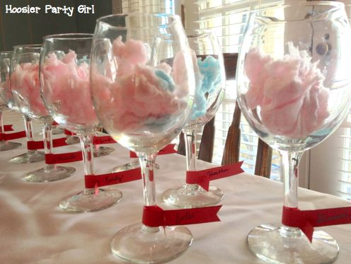 Cotton Candy Cocktails - Fill your glass with cotton candy and slowly pour champagne on top.  The different color cotton candy gives the cocktails different shades.