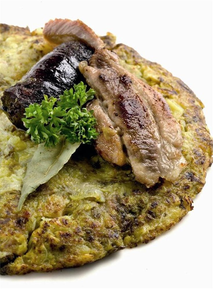 Trinxat de la Cerdanya.Trinxat is a food from Catalonia, made with potatoes, cabbage and pork meat.  Catalonia