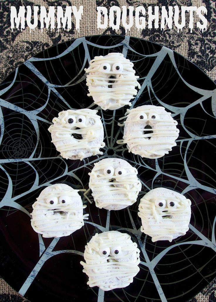Mummy Doughnuts - doctor up some powdered doughnuts for quick Halloween breakfast idea - also great for classroom parties!