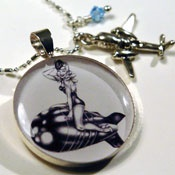My friend, Kristi, is a great artist. She does pin ups in the form of jewelry and portraits.