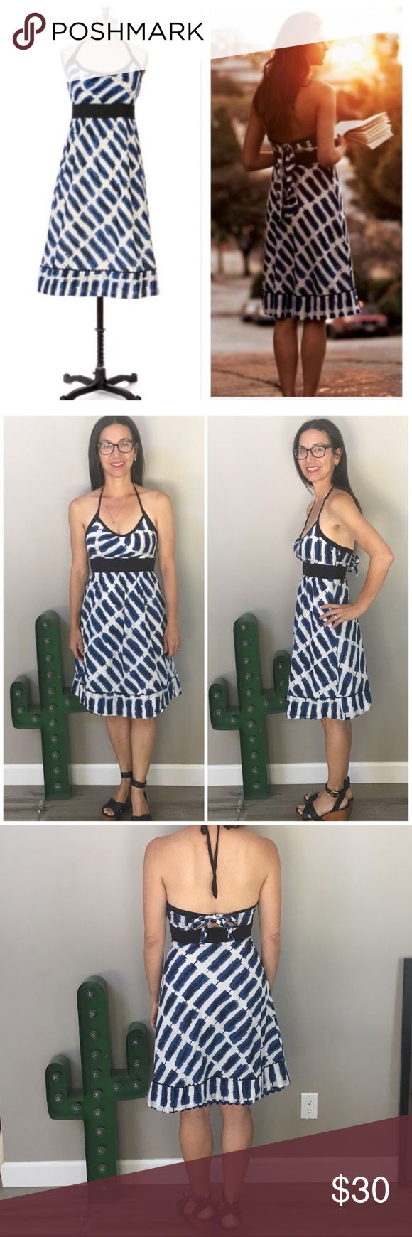 """HP5/27🎉Anthropologie Maeve Setting Westward dress Setting Westward halter dress from Maeve purchased at Anthropologie. Scattered indigo shapes float atop a gauzy off-white voile horizon. Inset at the empire waist with a comfortable band of black jersey. Beautiful blue ric-rac detail at lining hem.Side zipper. Tie halter neck & tie at waist in back make adjusting a breeze! Approx measurements when laid flat: length from top of bodice to hem 32"""". Width at band 12"""". Good preworn condition w…"""