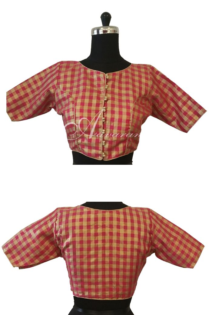 Delicate silk blouse featuring check patterns. Front button details and high neck.