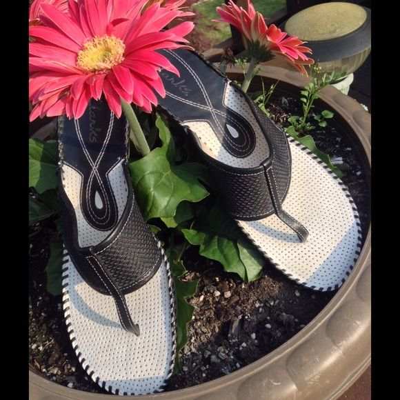 """Adorable Black/White Leather Clarks Sandals Adorable Black/White Leather Clarks Sandals 1 1/2"""" Wooden Heel. Bottom shows a little wear, but the top and sole are like new. Maybe worn twice. Clarks Shoes Sandals"""