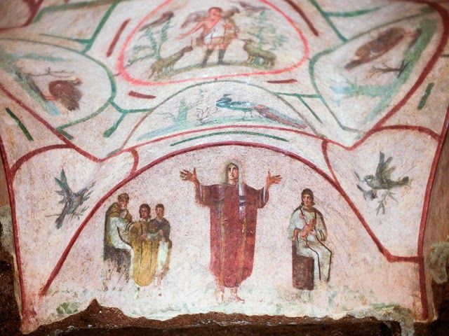 A fresco is pictured inside the catacomb of Priscilla in Rome November 19, 2013. The catacomb, used for Christian burials from the late 2nd century through the 4th century, reopened on Tuesday to the public after years of restoration. The complex will also be viewable in a dedicated section of Google Maps, according to a Vatican press release [Credit: Reuters/Max Rossi]