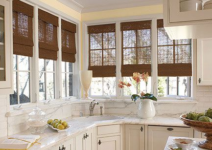 corner sink in this kitchen is surrounded by all the bright light from the wonderful windows: sink windows window love