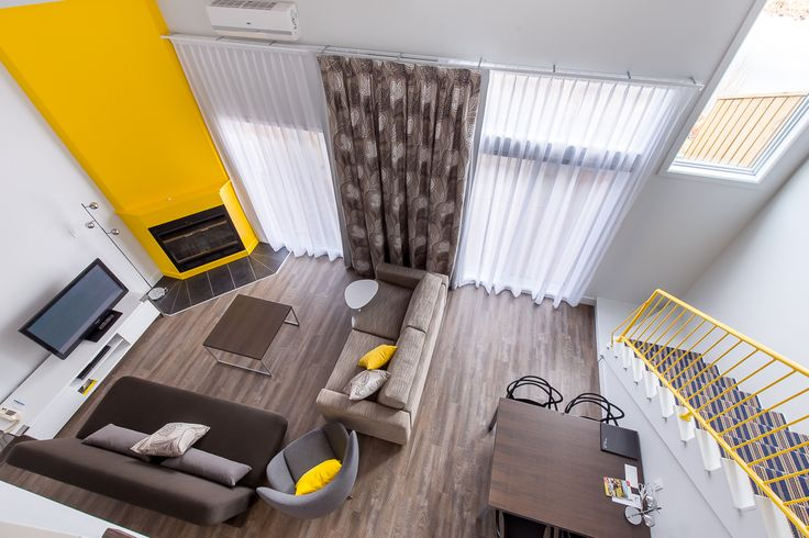 New Getaway Suites, modern living room with a pop of color and design furniture.
