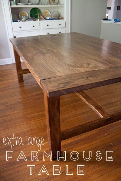Extra large farmhouse style table, plus free plans to build your own! We love this table for its clean lines, wide planks, and notched stretcher details.