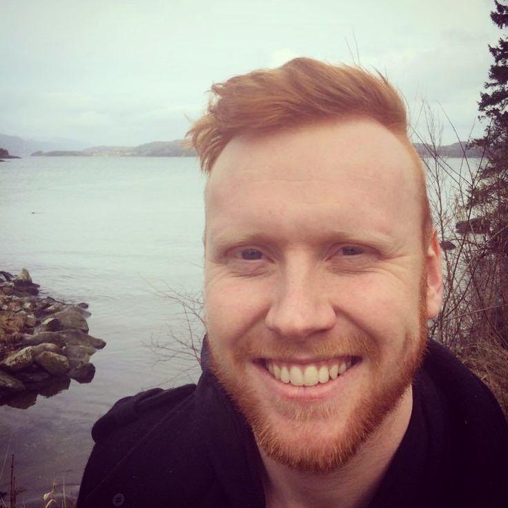 Hunky redhead doing his sexy smile down by the seashore. Gingerbeard, Beard.