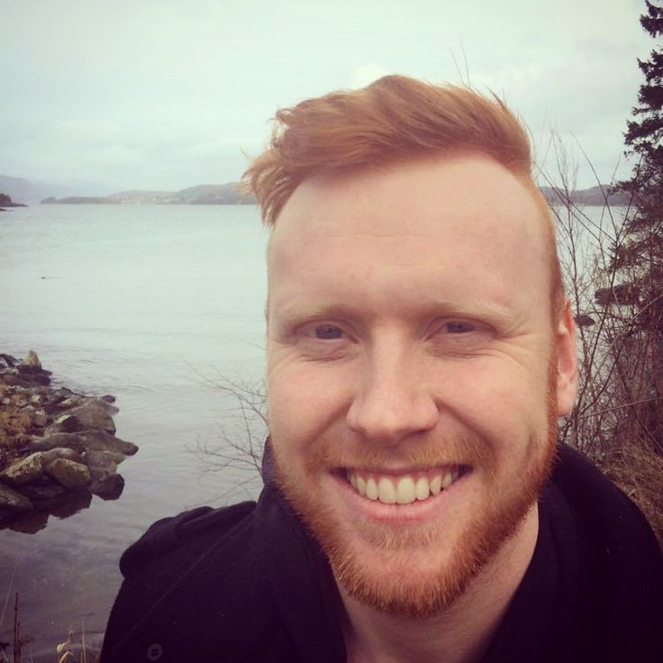 Hunky redhead doing his sexy smile down by the seashore. Gingerbeard, Beard.