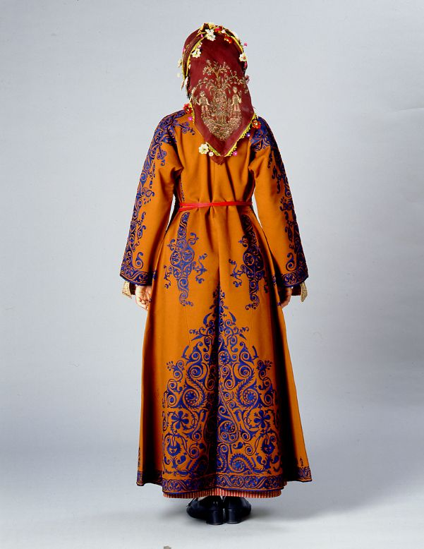 Front and back of a woman's festive dress from Nigde, Cappadokia made completely of bright colour felt an contrasting silk cord embroidery. - 1900's