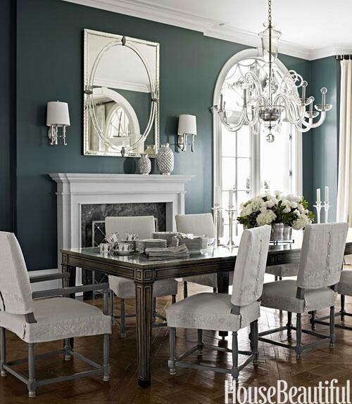 Beautiful classically styled dining room: bronze, grey, off-white and deep sea-green support a room where mirror and glass is used lavishly to establish a feeling of historic grandeur.