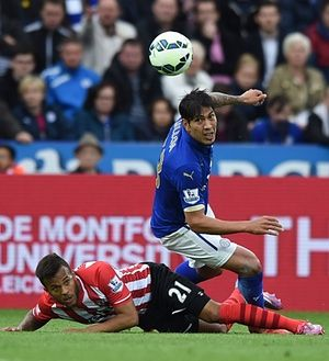 Leicester City's striker Leonardo Ulloa is tackled by Southampton's Ryan Bertrand at the King Power Stadium in Leicester. Riyad Mahrez hit the back of the net twice as Leicester took another step towards Premier League safety