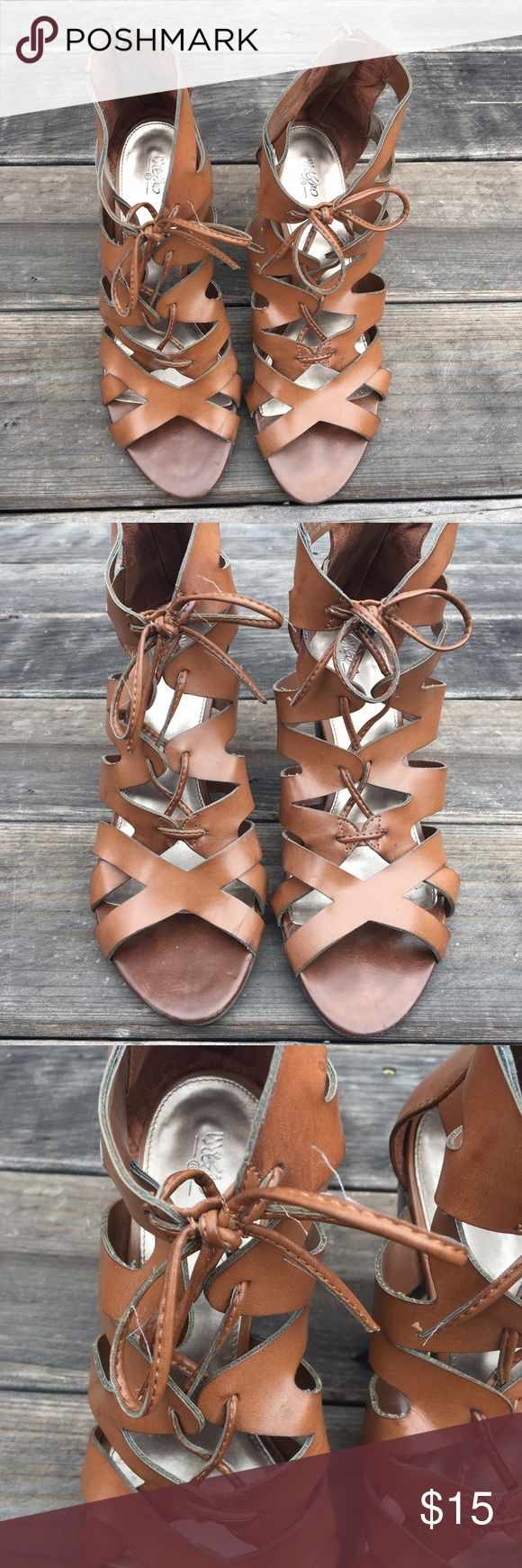 """Mossimo Brown Strappy Sandles Size 9 Mossimo brand brown strappy heeled sandles. Size 9. Zipper on heel with YKK imprint. Tie in front for decoration that """"laces"""" sandles together but is unnecessary for use. Preowned and worn a few times. Some wear. Few a"""