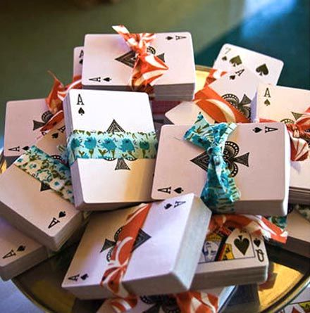 Decks of playing cards tied up with ribbon and a thank you tag make great party favors.