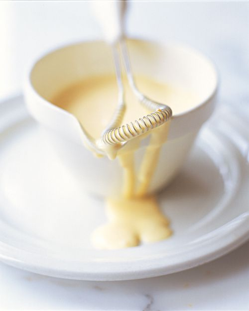 Classic Hollandaise Sauce  2 tablespoons white wine vinegar  2 tablespoons cold water  1 teaspoon lightly crushed white peppercorns  4 large egg yolks  2 sticks unsalted butter, clarified (see LC Classic Hollandaise Sauce Note above) or melted  Juice of 1/2 lemon  Salt and freshly cracked black pepper  A pinch cayenne pepper