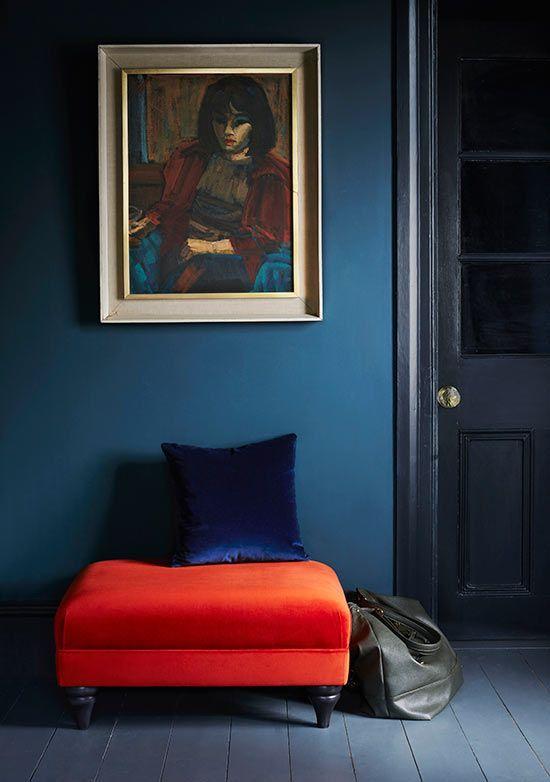 Blue interior with jewel tones via arlo & jacob | dark petrol blue wall paint | rich deep orange velvet footstool | oil painting | dark blue velvet cushion | Nail the trend with a Designers Guild Sea zaragoza vintage velvet cushion from Bemz