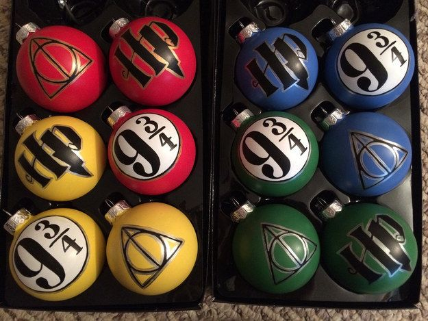 Set of 3 Hogwarts house-colored ornaments, $35   14 Harry Potter Holiday Ornaments That Are Absolutely Magical