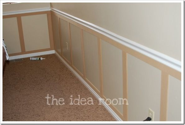 DIY Wainscotting... using 1/4 inch MDF board cut into 2in (horizontal) and 3in (vertical) sections. They were first glued in place with painter's caulk and then nailed in the top and bottom to secure them permanently.