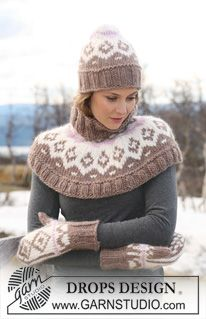 """Set comprises: DROPS shoulder wrap, hat and mittens with multi colored pattern in """"Eskimo """". ~ DROPS Design"""