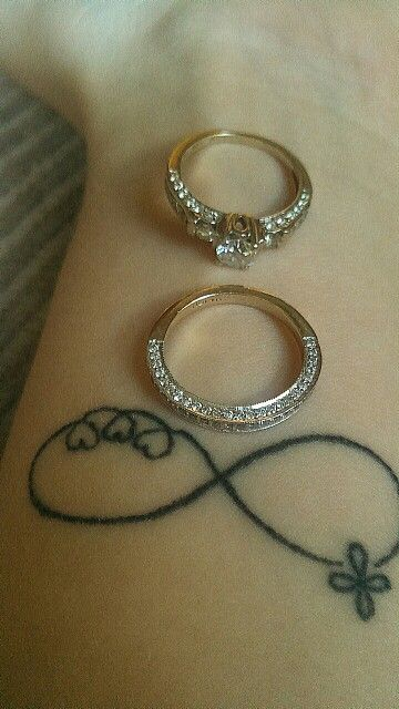 My tattoo, infinitly family, marriage and faith with my engagement ring and wedding band