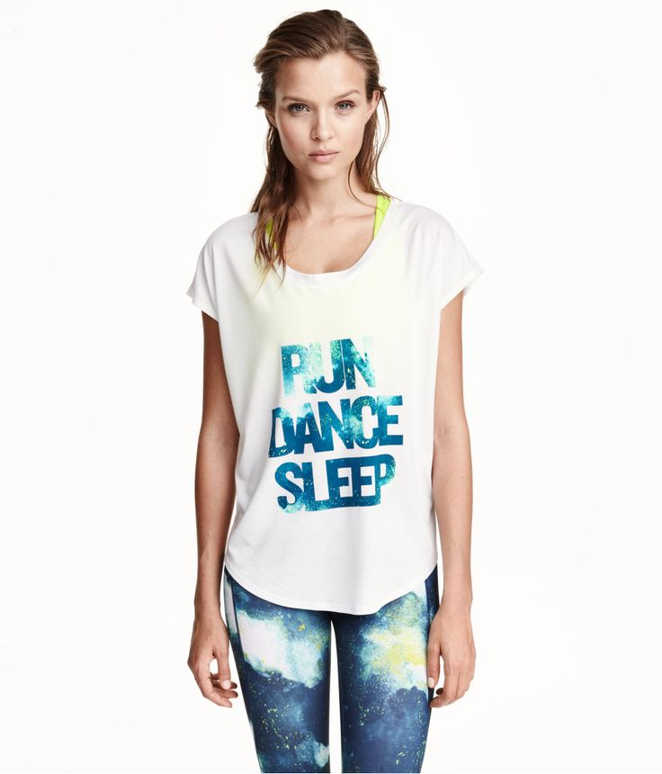 Run, dance, sleep, repeat! White sports top with cosmic text & short sleeves.   H&M Sport