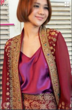 Bunga citra lestari on fuchsia songket