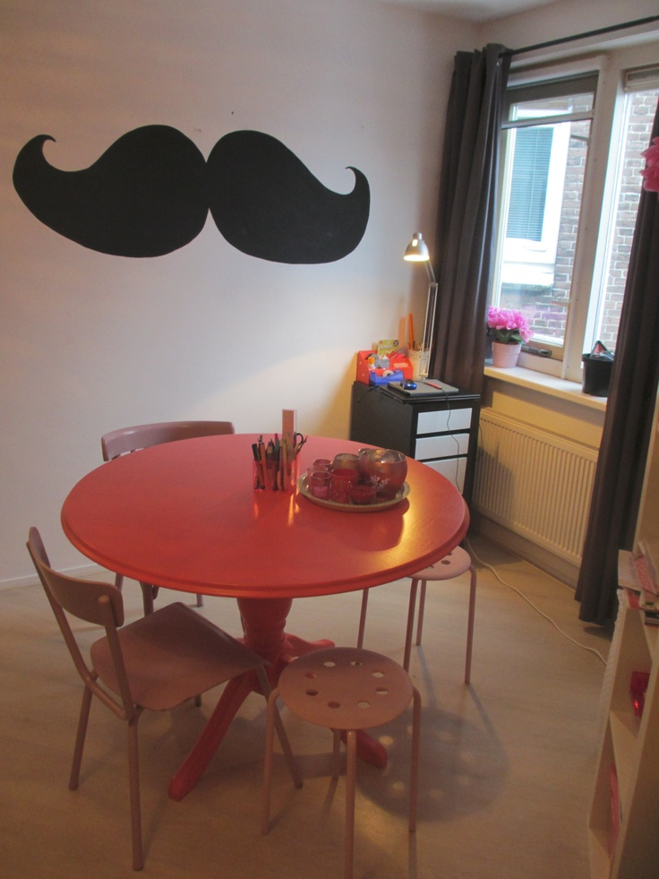 Jessies room,second hand table & chalkboard moustache.