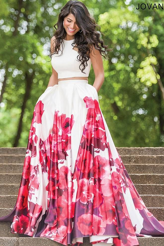 Two piece white multi floor length and halter neckline prom dress with A line skirt and pockets.