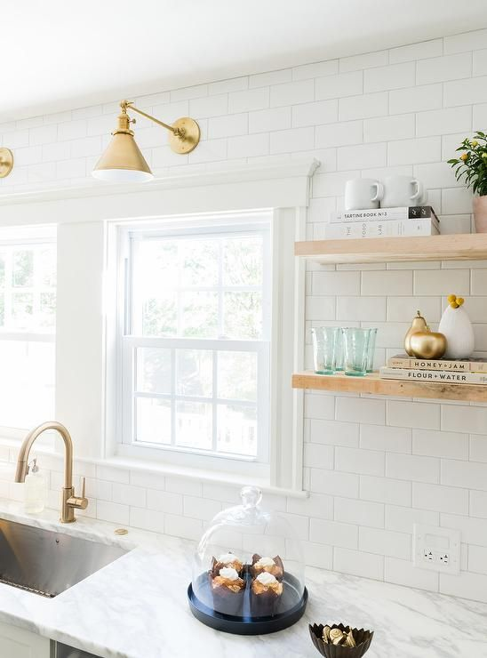 white subway tile backsplash white and gold kitchen features white shaker cabinets adorned with brass pulls paired with calcutta marble - White Kitchen With Subway Tile Backsplas