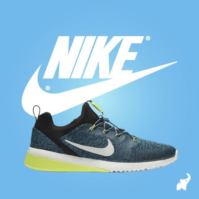Zapatillas deportivas Nike azul blanco y verde.