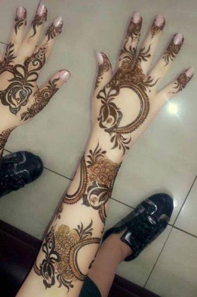 Arabic henna design. Rosy arms.