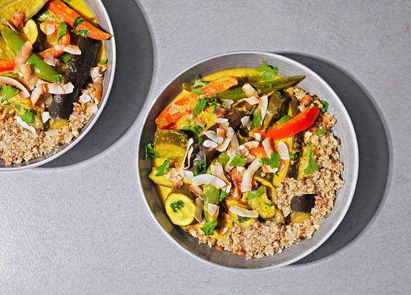 Our gluten-free Thai vegetable curry recipe is made with a homemade turmeric-yellow curry paste, packed with aubergines and courgettes and served with quinoa