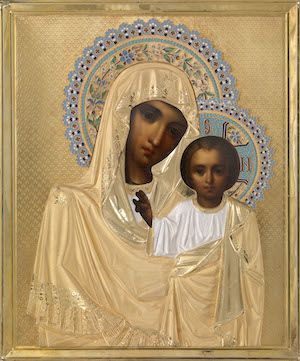 The Mother of God of Kazan with Silver-Gilt and Enamel Oklad and a Wooden Kiot    OKLAD STAMPED WITH MAKER'S MARK OF 'I.G.' IN CYRILLIC, ST PETERSBURG, LATE 19TH CENTURY, OIL ON PANEL