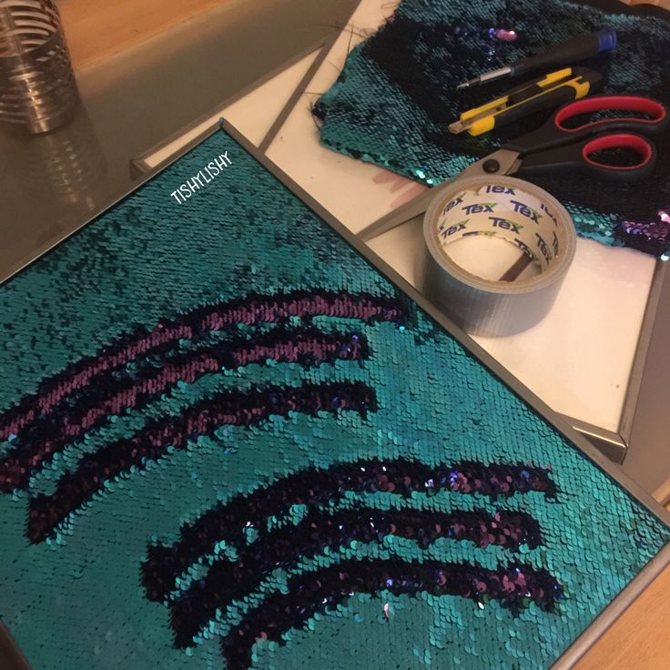 Mermaid fabric attached to frames for children to touch and explore.