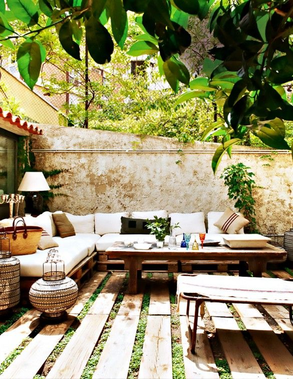 Tour a Feminine, Collected Barcelona Home // Charming Outdoor Space With Palette Seating