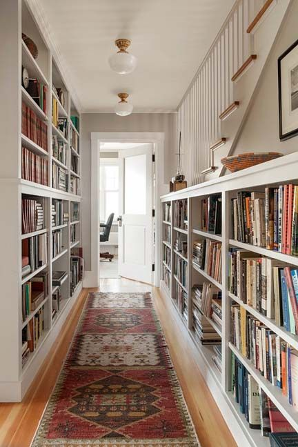 Books for days. Bookshelves in the Hallway with a classic oriental rug via @homebunch